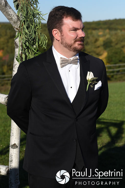 JD looks at Brooke as she walks down the aisle during his October 2016 wedding ceremony at The Farm at SummitWynds in Jefferson, Massachusetts.