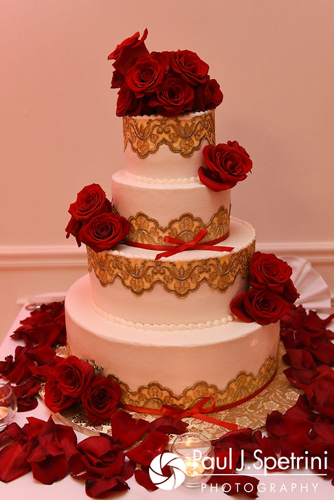A look at the wedding cake on display during Cynthia and Ao's August 2017 wedding reception at Lake Pearl in Wrentham, Massachusetts.