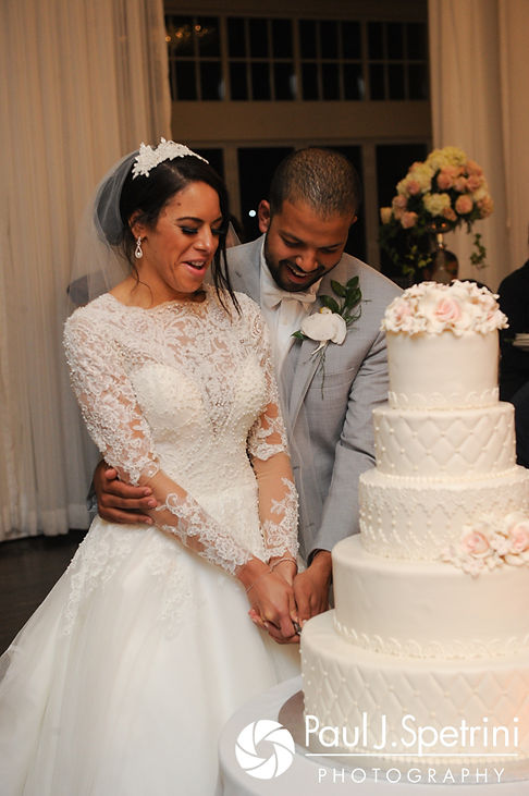 Nashua and Nader cut their cake during their July 2017 wedding reception at Belle Mer in Newport, Rhode Island.