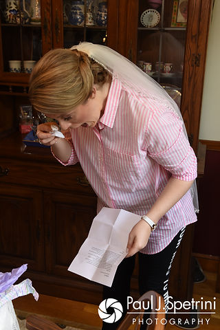 Melissa reads notes from her bridesmaids during her May 2017 bridal prep session at her mother's home in Bristol, Rhode Island.