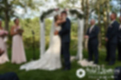 Kim and Matt share their first kiss during their August 2016 wedding at Whispering Pines Conference Center in West Greenwich, Rhode Island.