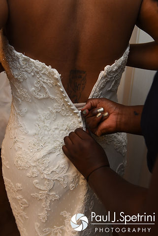 Jennifer has her dress zipped up prior to her September 2016 wedding at the Roger Williams Park Temple of Music in Providence, Rhode Island.
