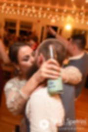 Arielle and Gary kiss during their September 2017 wedding reception at North Beach Club House in Narragansett, Rhode Island.