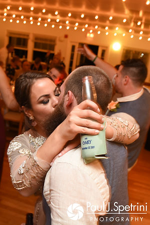 Arielle and Gary kiss during their September 2017 wedding reception at North Beach Club House in Narragansett, Rhode Island.