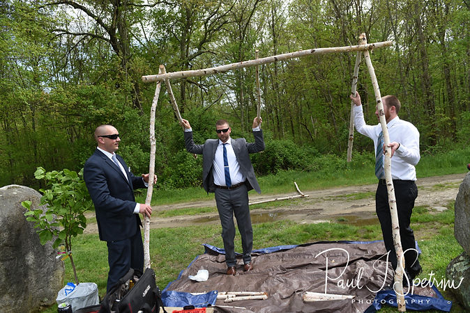 Mike and his friends build an arch prior to his May 2018 wedding ceremony at Bittersweet Farm in Westport, Massachusetts.