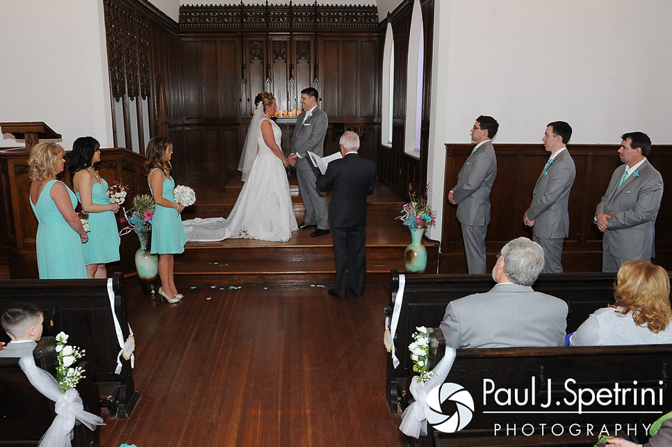 Angela and Shawn hold hands at the Kay Chapel in Newport, Rhode Island during their spring 2016 Rhode Island wedding.
