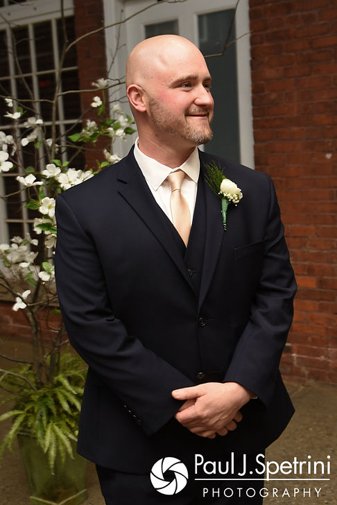 Matthew smiles as he watches Meridith walk down the aisle during their May 2017 wedding ceremony at the Hope Artiste Village in Pawtucket, Rhode Island.