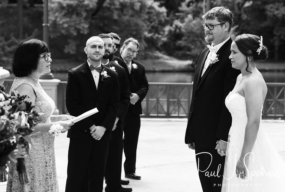 Danielle and Mark hold hands during their August 2018 wedding ceremony at the Roger Williams Park Casino in Providence, Rhode Island.