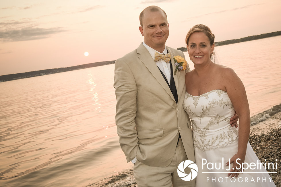 Rebecca and Kelly pose for a sunset photo during their August 2017 wedding reception in Warwick, Rhode Island.