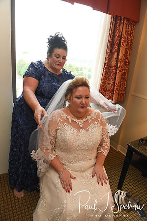 Patti has a veil placed on her head prior to her August 2018 wedding ceremony at the Walter J. Dempsey Memorial Bandstand in Norwood, Massachusetts.