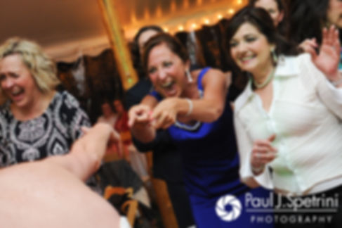 Guests dance during Caroline and Morgan's April wedding reception at the Fort Adams Trust in Newport, Rhode Island.