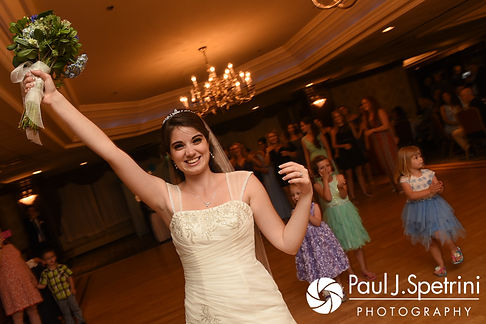 Gianna tosses her bouquet during her July 2017 wedding reception at Quidnessett Country Club in North Kingstown, Rhode Island.