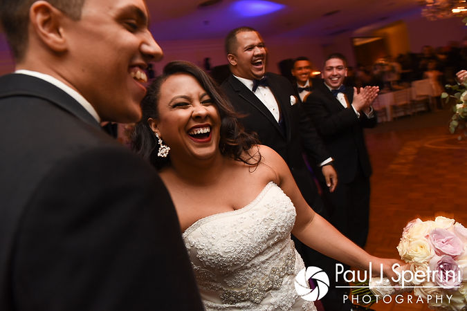 Stephany and Arten laugh during their September 2017 wedding reception at Wannamoisett Country Club in Rumford, Rhode Island.