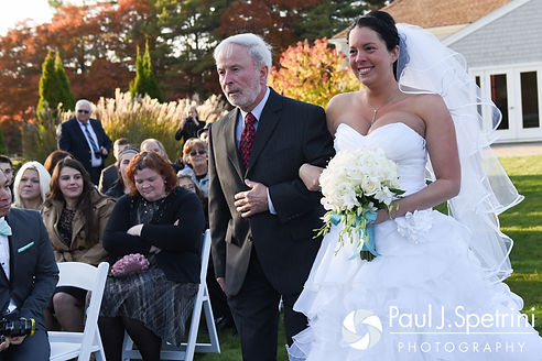 Kelly comes down the aisle with her father during her November 2016 wedding ceremony at the Bay Pointe Club in Buzzards Bay, Massachusetts.