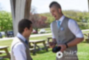 Ian shares a laugh with a groomsman prior to his May 2016 wedding at Colt State Park in Bristol, Rhode Island.