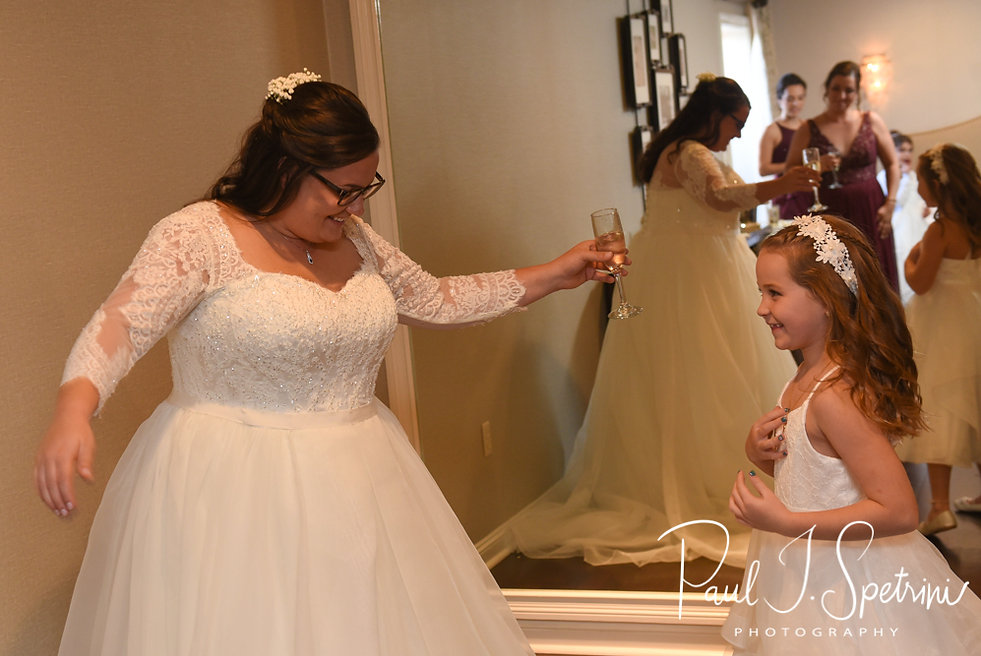 Katie twirls in her dress prior to her October 2018 wedding ceremony at The Villa at Ridder Country Club in East Bridgewater, Massachusetts.
