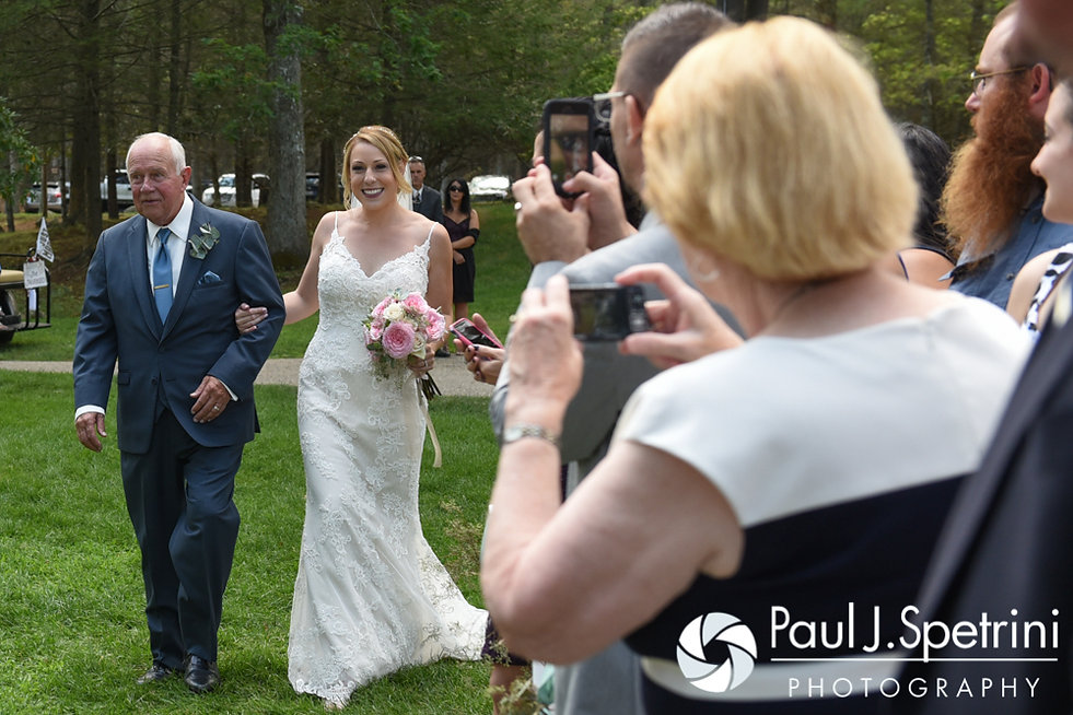 Kim and her dad walk down the aisle during her August 2016 wedding at Whispering Pines Conference Center in West Greenwich, Rhode Island.