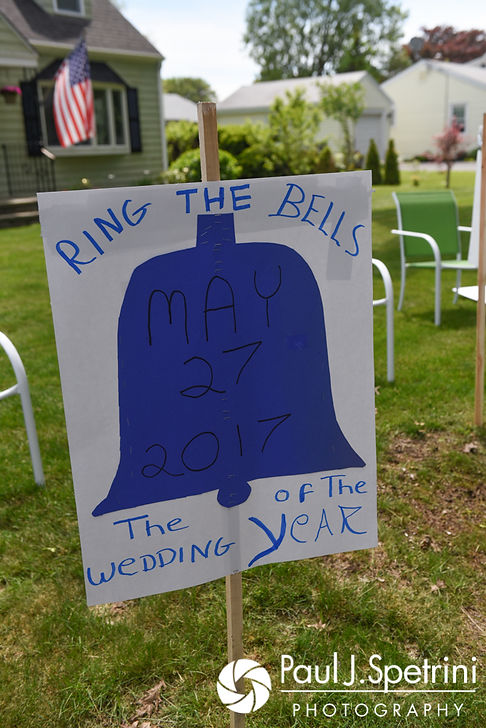 Neighbors wish Melissa well with a sign on display outside prior to her May 2017 bridal prep session at her mother's home in Bristol, Rhode Island.