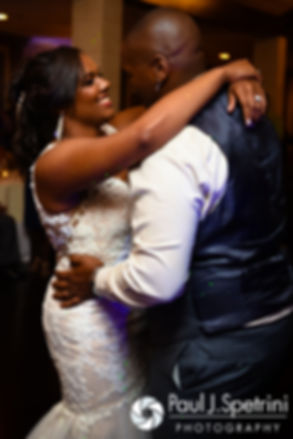 Kemi and Warren share their first dance during their August 2016 wedding reception at the Villa at Riddler Country Club in East Bridgewater, Massachusetts.