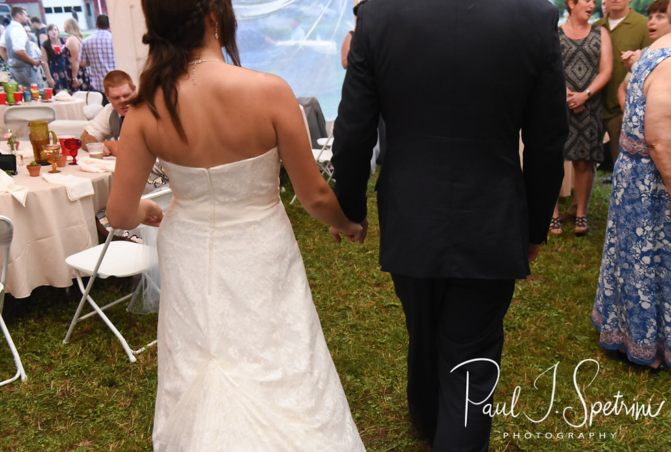 Karolyn & Ethan hold hands during their August 2018 wedding reception at a private residence in Sterling, Connecticut.