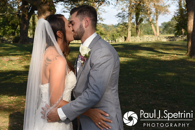 Stacey and John share their first kiss during their September 2017 wedding ceremony at Colt State Park in Bristol, Rhode Island.