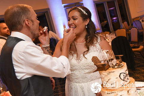 Toni and Scott cut their wedding cake during their August 2017 wedding reception at Crystal Lake Golf Club in Mapleville, Rhode Island.
