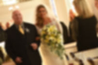 Cara and her father walk down the aisle during her November 2018 wedding ceremony at First Baptist Church in Hope Valley, Rhode Island.