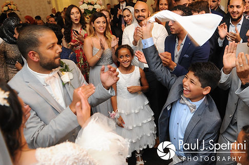 Nashua and Nader dance with friends and family to start their July 2017 wedding reception at Belle Mer in Newport, Rhode Island.