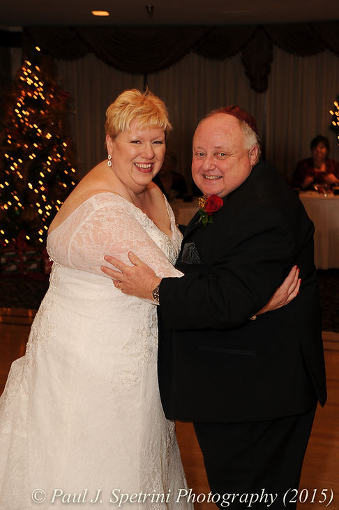 Cathy and Ron smile on the dance floor during their December 2015 Rhode Island wedding at Quidnessett Country Club in North Kingstown, RI.