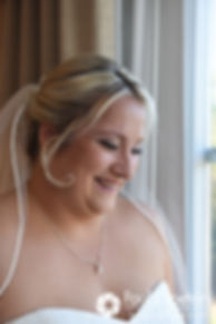 Jennifer laughs during a photo prior to her September 2017 wedding ceremony at Gazebo Park in Narragansett, Rhode Island.