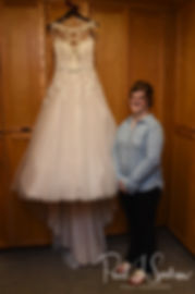 Kelly stands next to her wedding dress prior to her June 2018 wedding ceremony at Blissful Meadows Golf Club in Uxbridge, Massachusetts.
