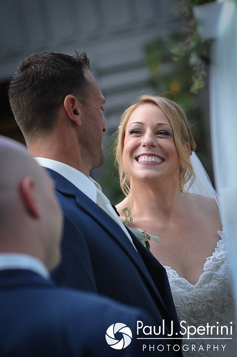 Kim smiles as she looks at Matt during her August 2016 wedding at Whispering Pines Conference Center in West Greenwich, Rhode Island.