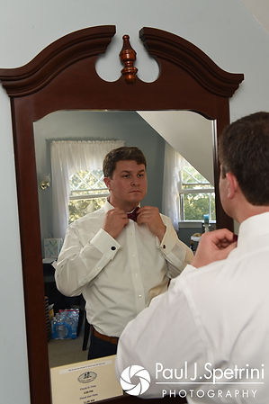 Mike puts his tie on prior to his October 2017 wedding ceremony at Castle Manor Inn in Gloucester, Massachusetts.