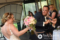 Kim and Matt enter their wedding reception at Whispering Pines Conference Center in West Greenwich, Rhode Island.