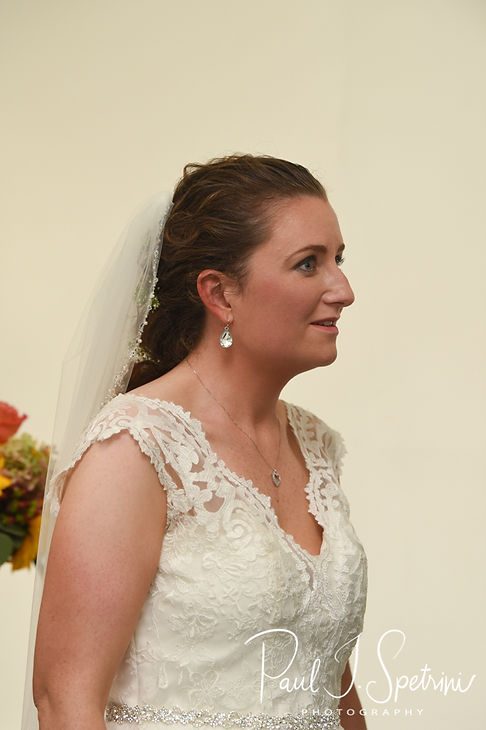 Allie looks at Rob during her October 2018 wedding ceremony at South Ferry Church in Narragansett, Rhode Island.