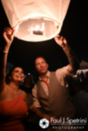 Guests release a Chinese lantern during Michelle and Eric's May 2016 wedding at Hillside Country Club in Rehoboth, Massachusetts.