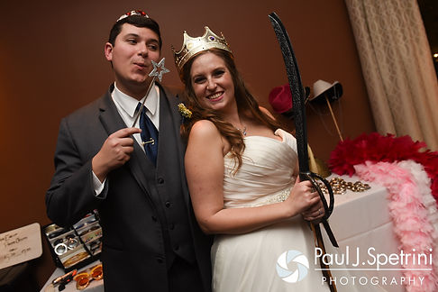 Kristin and Chris take a photo near the photo booth during their October 2016 wedding reception at the Ashworth by the Sea Hotel in Hampton, New Hampshire.