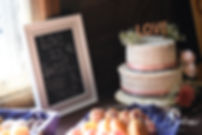 A look at the wedding cake, seen on display during Adam & Ashley's September 2018 wedding reception at Stepping Stone Ranch in West Greenwich, Rhode Island.