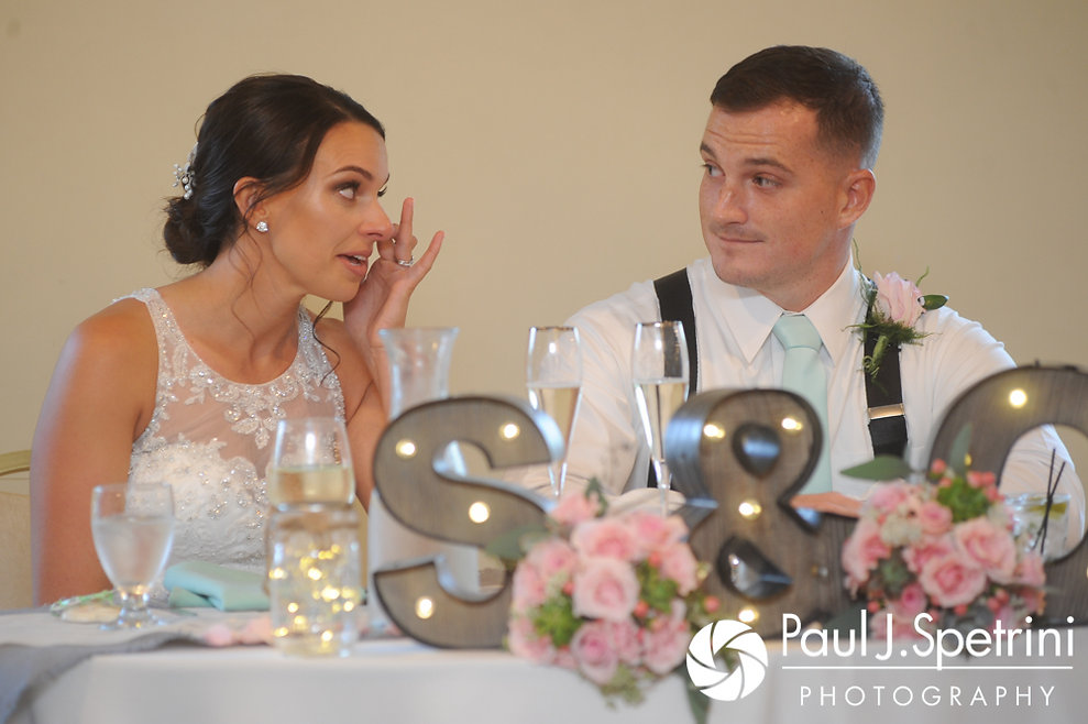 Sean and Cassie listen to the toasts during their July 2017 wedding reception at Rachel's Lakeside in Dartmouth, Massachusetts.