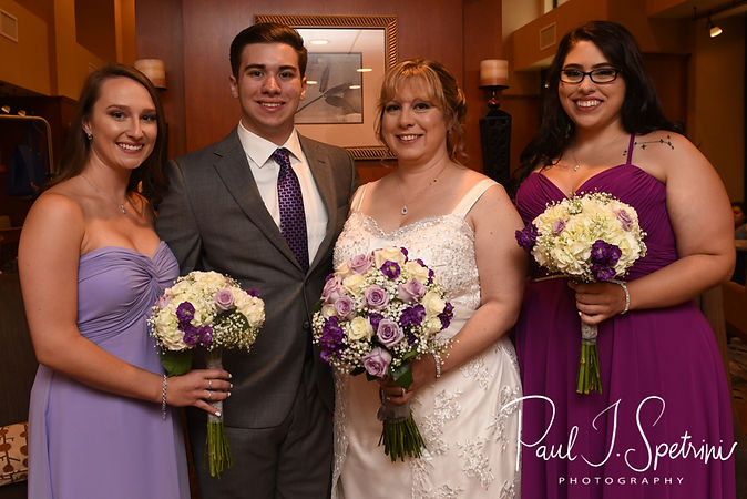 Robin takes a photo with her two children and daughter-in-law prior to her August 2018 wedding ceremony at Twelve Acres in Smithfield, Rhode Island.