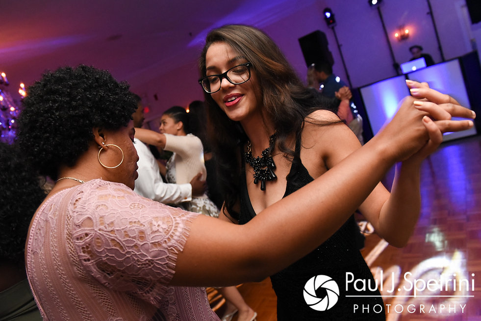 Guests dance during Stephany and Arten's September 2017 wedding reception at Wannamoisett Country Club in Rumford, Rhode Island.