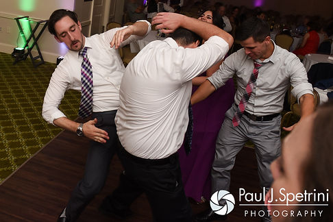 Guests dance during Alyssa and Alex's August 2016 wedding reception at LeBaron Hills Country Club in Lakeville, Massachusetts.