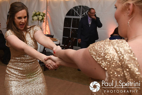 Guests dance during JD and Brooke's October 2016 wedding reception at The Farm at SummitWynds in Jefferson, Massachusetts.