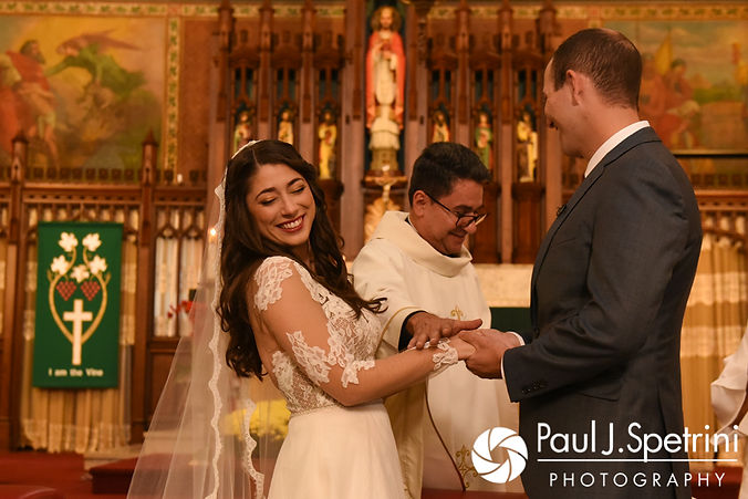 Keiran and Jessica laugh during their October 2017 wedding ceremony at the Assumption of the Blessed Virgin Mary Church in Providence, Rhode Island.