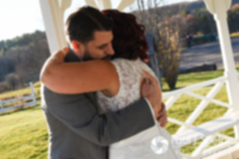 Andy hugs Crystal during their first look prior to their November 2016 wedding ceremony at the Salem Cross Inn in West Brookfield, Massachusetts.
