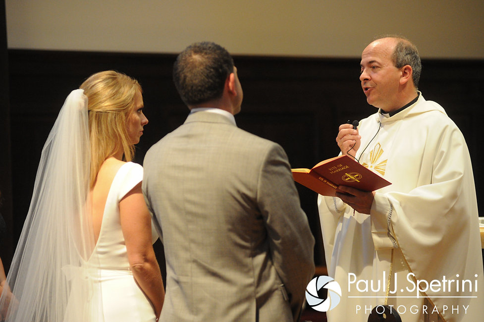 A priest says a prayer during Amy and DJ's June 2016 wedding ceremony at St. Thomas More Church in Narragansett, Rhode Island.