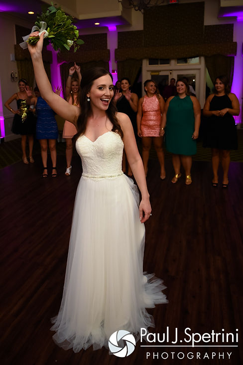 Alyssa gets ready to throw her bouquet during her August 2016 wedding reception at LeBaron Hills Country Club in Lakeville, Massachusetts.