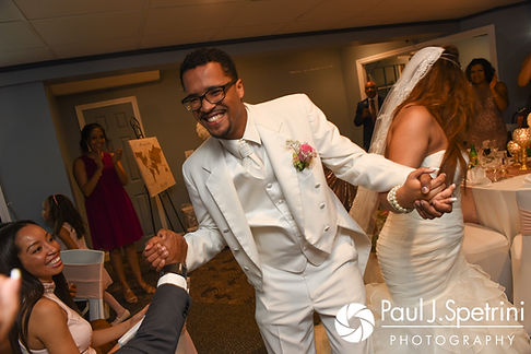 Luis and Lucelene walk into their June 2017 wedding reception at Al's Waterfront Restaurant in East Providence, Rhode Island.