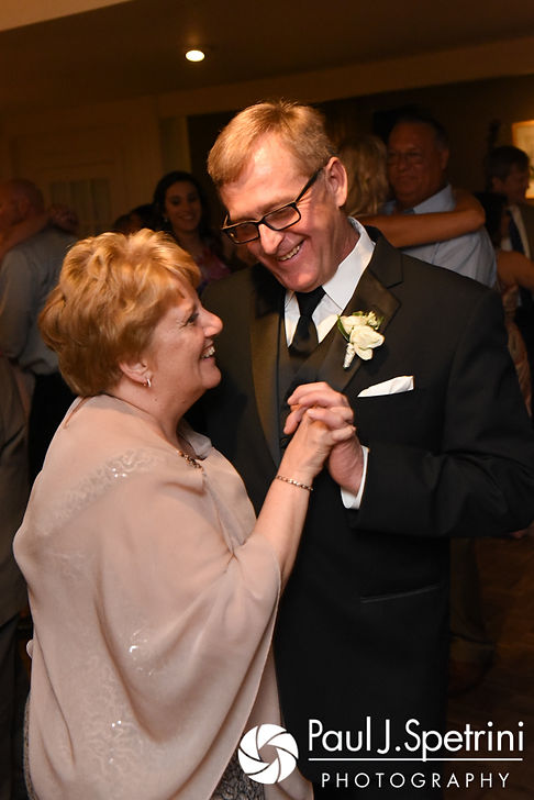 Melissa's parents dance during their daughter's May 2017 wedding reception at Independence Harbor in Assonet, Massachusetts.