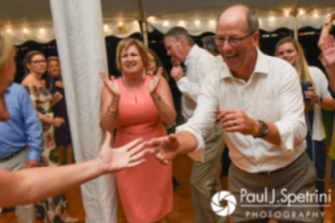 Guests dance during Rebecca and Kelly's August 2017 wedding reception in Warwick, Rhode Island.